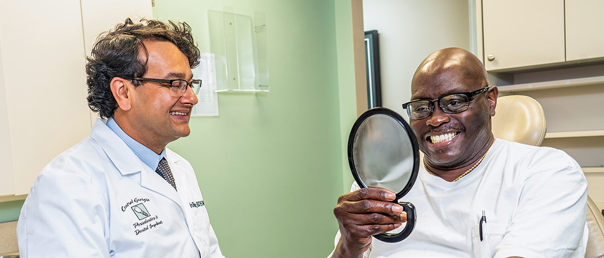 Image of Dr. Bhasin in a consultation with a patient.
